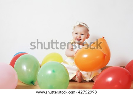 little girl in balloons
