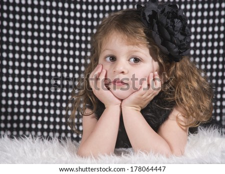 Little Girl in black with a hair bow
