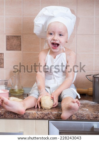 little girl in the cook costume