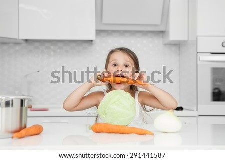 little girl in the kitchen preparing