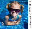little girl in the pool - stock photo