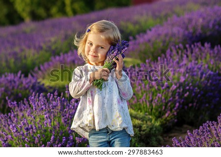 Little girl is in Lavender field.  Author photo processing.