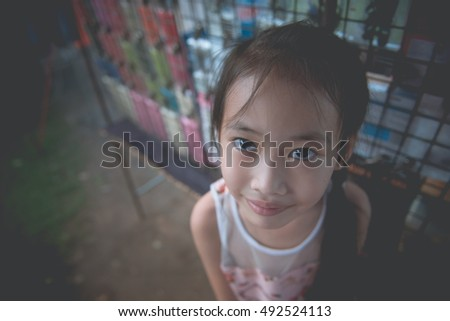 Little girl make mouth wow she use hand touch face vintage style,dark tone,cute,film,pastel,low key