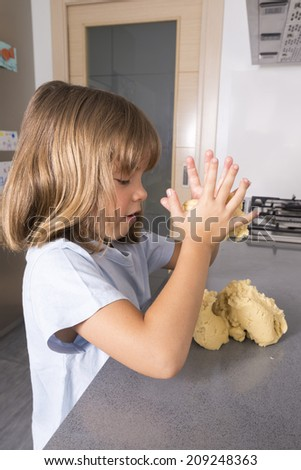 Little girl making cookie dough at home