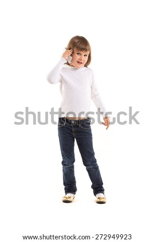 little girl making phone call using smartphone on white background