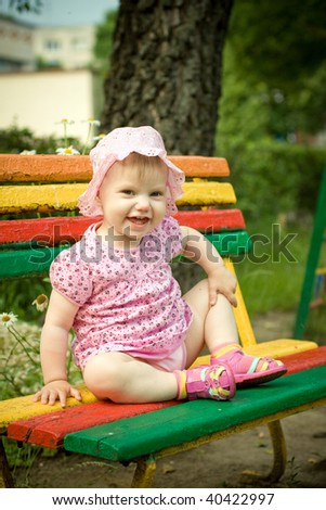 little girl on the bench in park