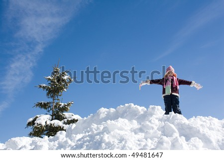 little girl playing on the snow
