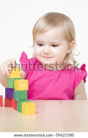 Little girl playing with bricks