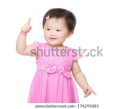 Little girl pointing up with finger