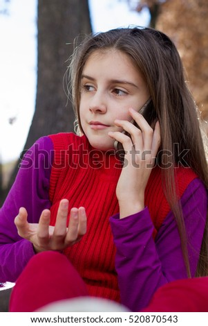 Little girl talking to phone