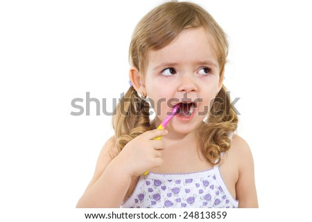 Little girl thinking while washing teeth - isolated