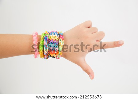 Little girl wearing colorful loom band rubber bracelet