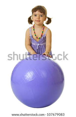 Little girl with a large rubber ball isolated on white background