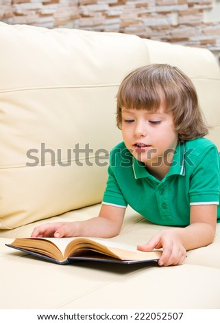 Little girl with book at light room