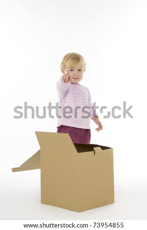 Little girl with box, on white background.