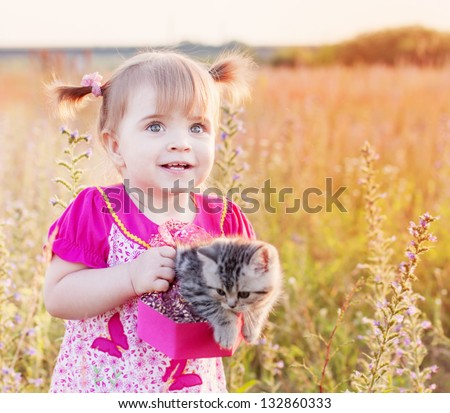 little girl with cat outdoor