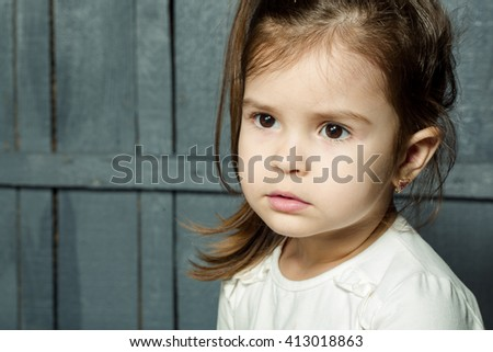 Little girl with funny face closeup. Childhood and emotions