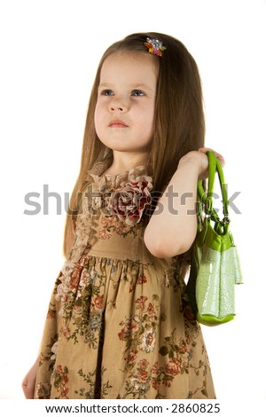 Little girl with green bag in a  shopping day