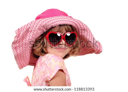 little girl with hat and sunglasses portrait