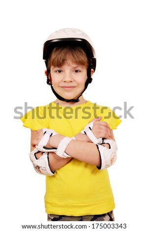 little girl with rolling skates protective gear posing