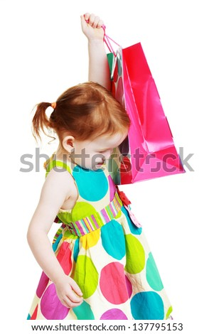 little girl with shopping bag cheerful shopaholic isolated over white