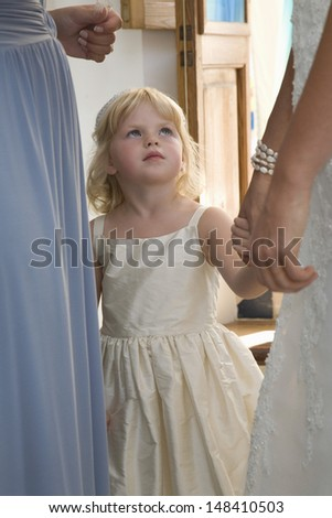 Little girl with two midsection women at wedding reception