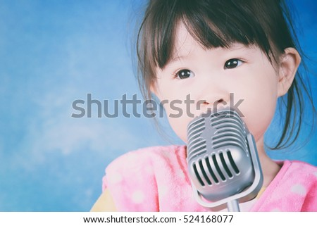 little girl with vintage microphone retro style