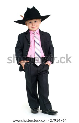 Little handsome boy in elegant suit and hat