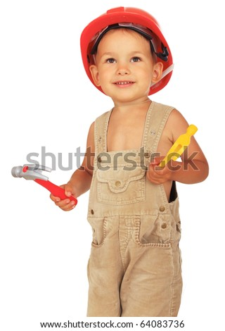 Little kid as a construction worker in red protective helmet on white background