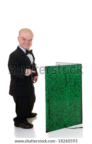 Little man, dwarf waiter in a formal suit with bow tie and over sized menu card, studio shot, white background