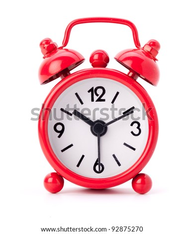 Little red alarm clock on a white background
