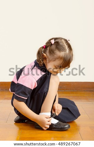 Little girl black dress sitting on stock photo 231920464 - App that puts santa in your living room ...