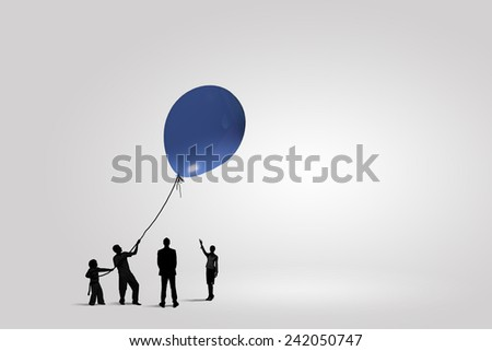 Little silhouettes of people pulling rope with balloon