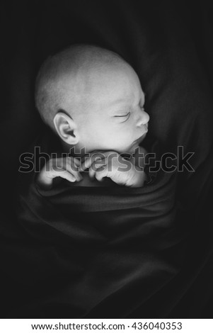 Little Sleeping Cute Newborn Baby. Ear in Focus. Brown background