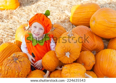 little smiling boy in pumpkin costume ready for halloween