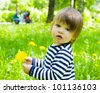 Little toddler girl walk outdoors and holding yellow flower dandelions - stock photo