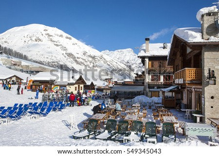 LIVIGNO, ITALY - 2 JANUARY 2016: View to lounge with sunbeds near ski slope in Livigno village, Itali, January 2016