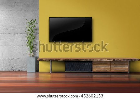 Living Room Led Tv On Yellow Wall With Wooden Table And Plant In Pot Modern  Loft