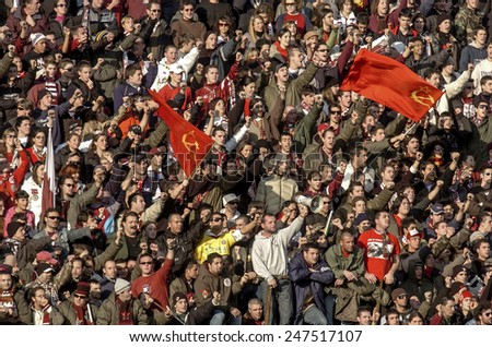 LIVORNO, ITALY-JANUARY 06, 2005: Livorno soccer fans waving communist flags at the stadium during a soccer match Livorno vs AC Milan, in Livorno.