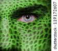 Lizard skin pattern on man face - stock photo