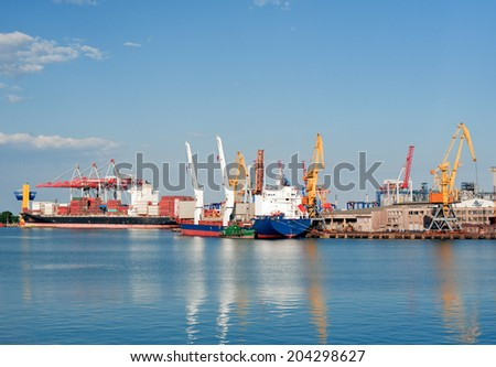 Loading at the port. Ships at sea for loading. Cranes and containers. Cargo sea port