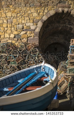 Lobster Nets and fishing boat at Beadnell Harbour, Northumberland