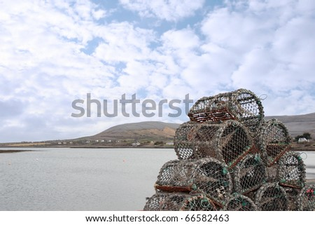 lobster pots on a quay in a bay in ireland