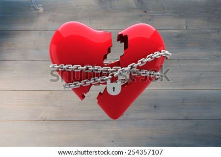 Locked heart against bleached wooden planks background