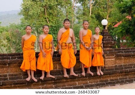 LOEI, THAILAND - April 10: A group of child monks at Wat Neramit Vipasama, Dansai, Loei, Thailand on the April 10, 2015