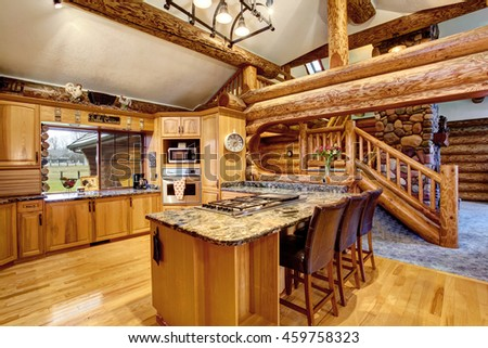 log cabin kitchen interior design with large honey color storage combination and kitchen island with stone