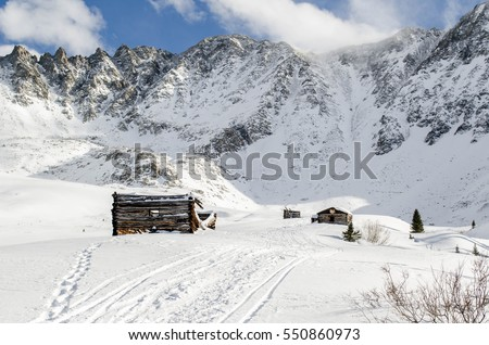 Log cabins at Mayflower Gulch in the winter