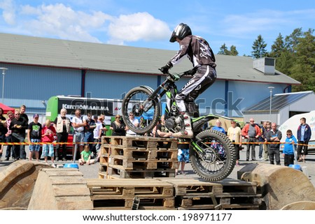 LOIMAA, FINLAND - JUNE 15, 2014: Finnish Champion Timo Myohanen gives the audience an exciting show in Motorcycle Trials at HeMa Show 2014 in Loimaa, Finland.
