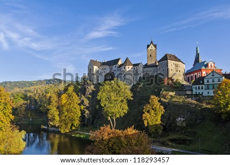 Loket Castle is a 12th-century Gothic style castle located about 12 km from Karlovy Vary on a massive rock in the town of Loket