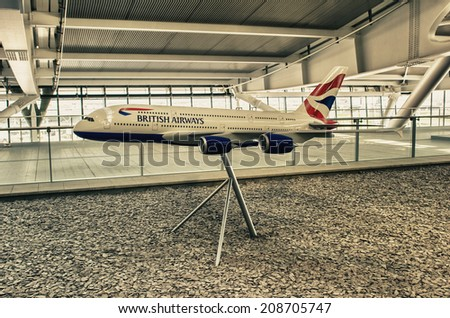 LONDON - APRIL 11, 2014: British Airways airplane in Heathrow airport. British Airways is the flag carrier airline of the United Kingdom, operating 256 aircrafts